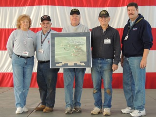 Mike Dunham presents MAPS with a picture of the Thunderbirds when they were F-100's