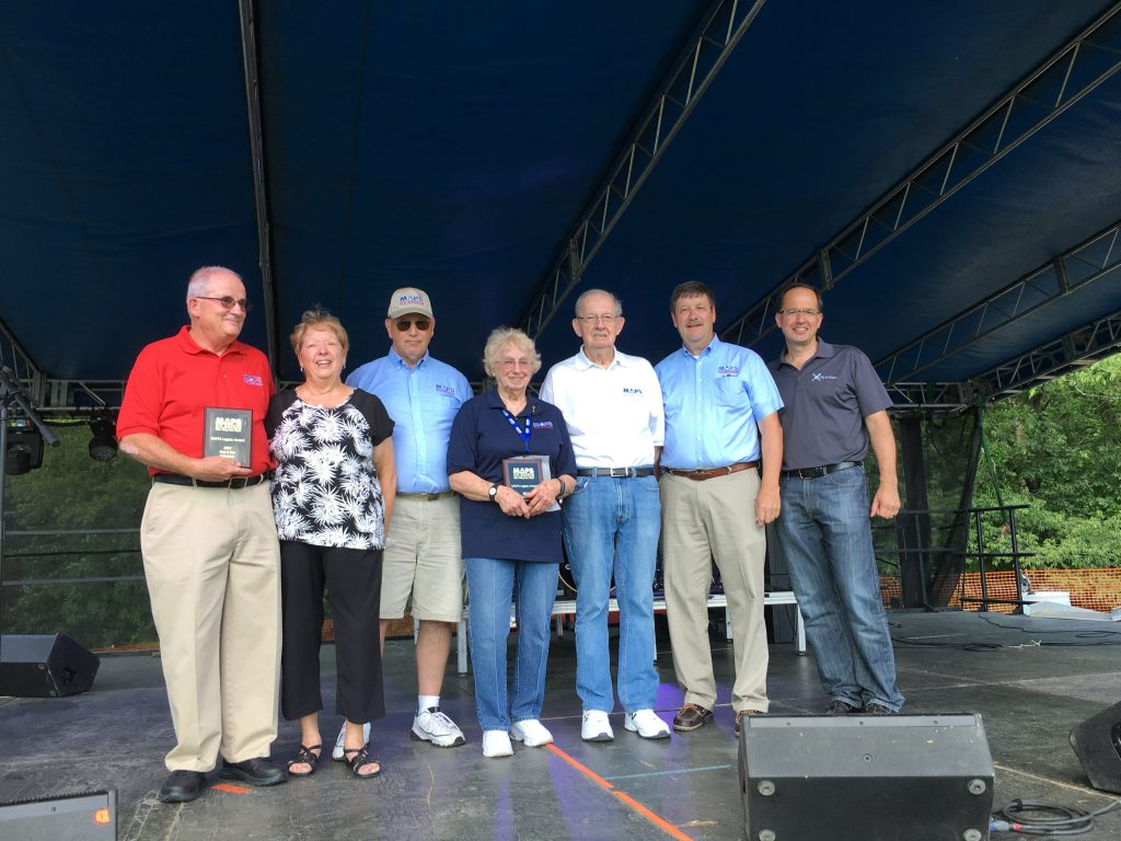 Pictured from left to right: Bob and Pat Schwartz, Rick Hamlet, Mary Ann and Jim Cameron, Kim Kovesci, and Green Mayor Gerard Neugebauer